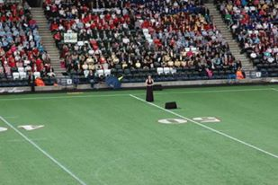 Soprano Zoe Curlett sings in stadium